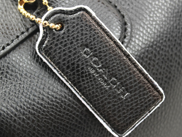 Handbag Edge Repair - Coach Custom - closeup of tag